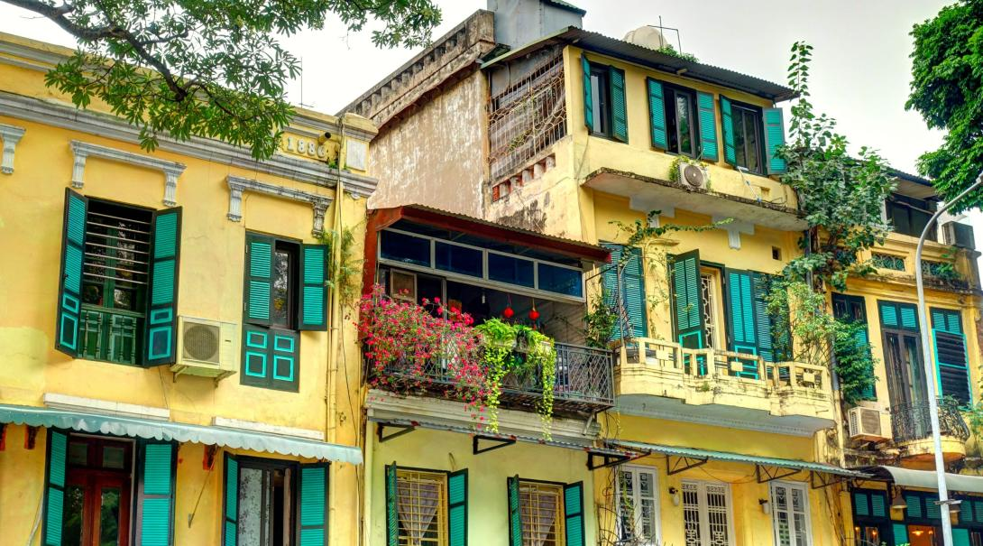 Travellers explore the French Quarter in Vietnam during the Food Tour.